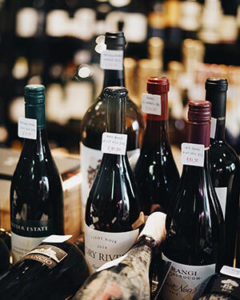 Wine suppliers displaying wine.